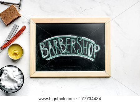 Tools for cutting beard in barbershop for men on white workplace background top view