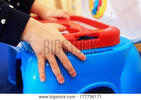 Child's Hands On Blue Toy Box