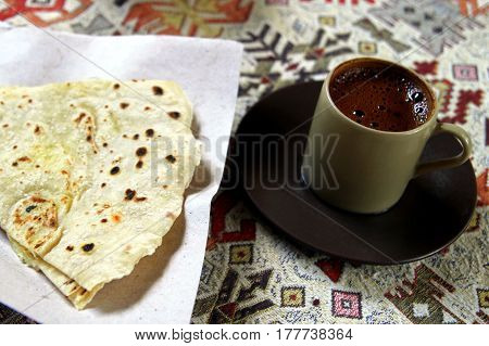 Travel To Cappadocia, Turkey. The Cup Of Flavored Turkish Coffee With Turkish Pancake.