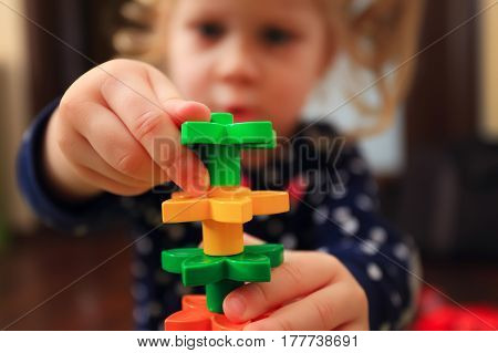 Child Trying Build Tower With Constructor