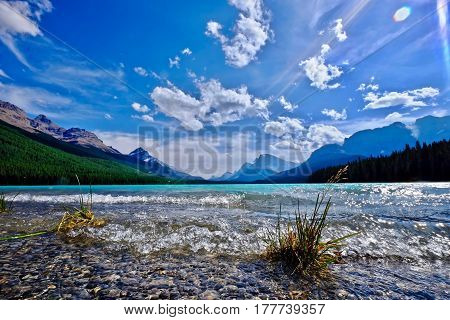 Tranquil emerald lake in mountains. Upper Waterfowl Lake in Canadian Rockies. Banff National Park. Rocky Mountains. Alberta. Canada.