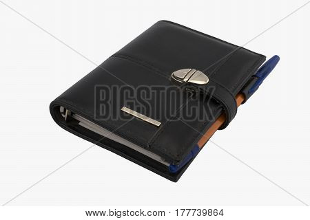 Business organizer and orange pen on the desk on a white background