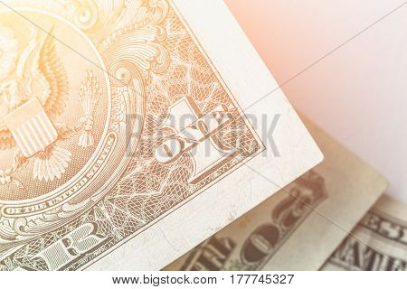 Cash, money, close-up photo, one US dollar bill banknote in sunlight filter effect, economy concept, copy space for text