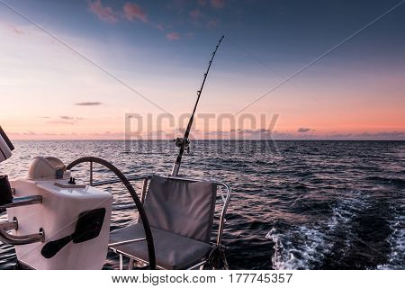 Sailing Yacht Catamaran Sailing In The Sea And Fishing