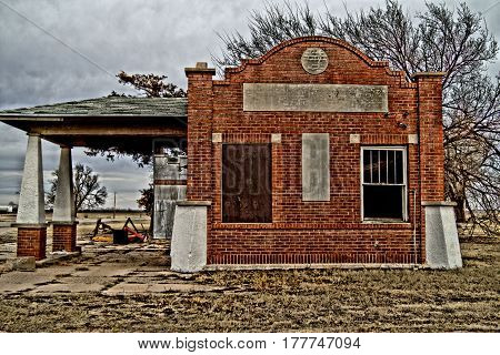 Old repair shop in small town off Highway