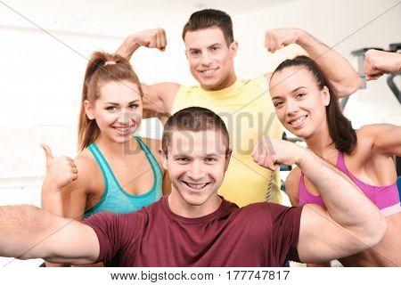 Group of people taking selfie in gym