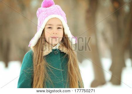 Pretty little girl walking on snow