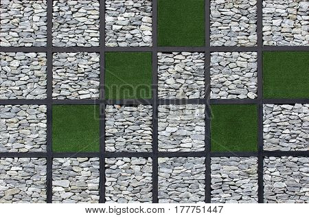 green grass and stone wall texture background