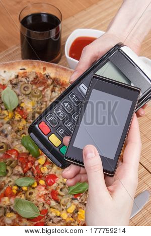 Using Payment Terminal And Mobile Phone With Nfc Technology For Paying In Restaurant, Vegetarian Piz