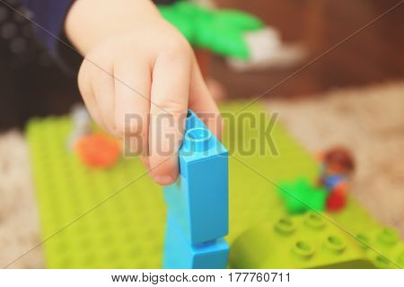 Kid Playing With Constructor