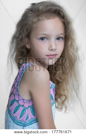 Portrait Of Little Girl Outdoors In Spring;