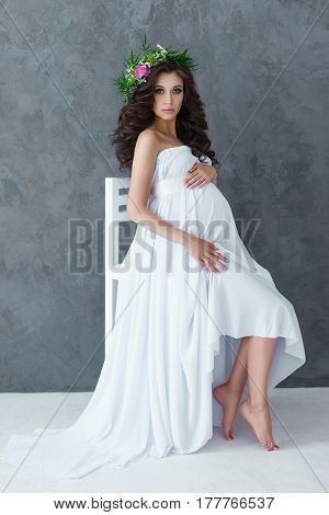 Portrait Of A Beautiful Young Pregnant Woman