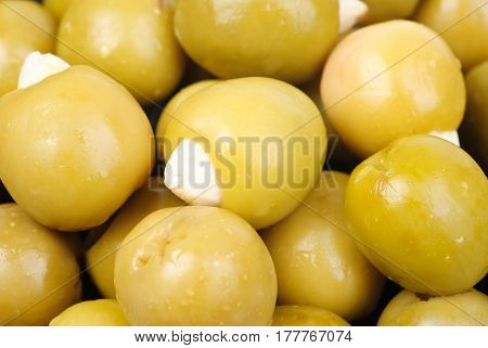 Green olives stuffed with almonds as food background