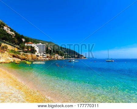 Dubrovnik, Croatia - June 07, 2015: Tourists resting on beach Banje at Dubrovnik old town on June 07, 2015, Croatia. Balkans, Adriatic sea, Europe