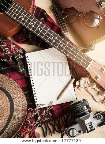 Blank notebook with ukulele and vacation stuff Travel concept