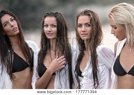Portrait Of Four Girls Girlfriends On The Beach In Summer