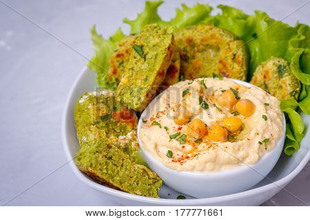 Bright green falafel with hummus. Love for a healthy vegan food concept