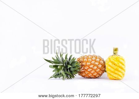peeled  pineapple and fresh ripe pineapple have sweet taste  on white background healthy pineapple fruit food isolated
