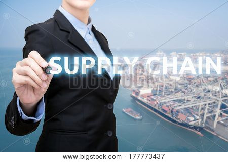 Smart Business Woman Is Writing Supply Chain Concept With Shipping Boat At Shipping Yard In Backgrou
