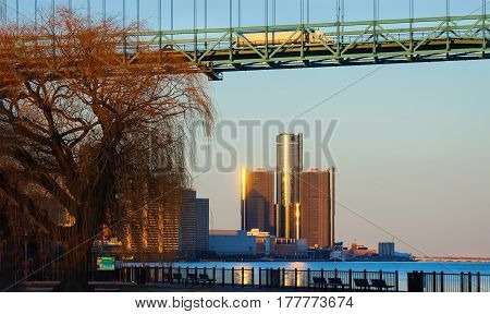 Downtown Detroit cityscape on great lakes river bridge trucking