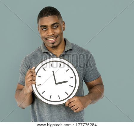 African Descent Man Holding Clock