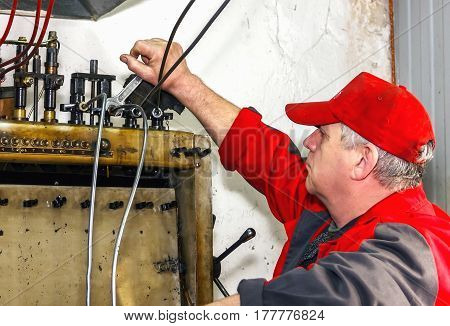 Professional Mechanics Testing Diesel Injector In His Workshop, Repair Of Diesel Fuel Injectors, Fue