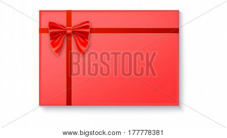 Gift box with big red bow and ribbon, isolated on white background. Top view on gift packaged in a paper
