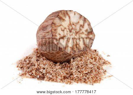 one nutmeg and powder isolated on white background.