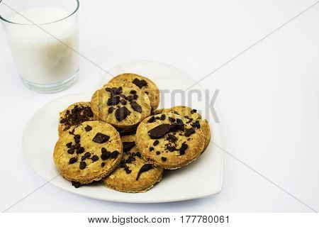 A plate of Gluten free Organic Homemade Chocolate Chip Cookies with a glass of Milk