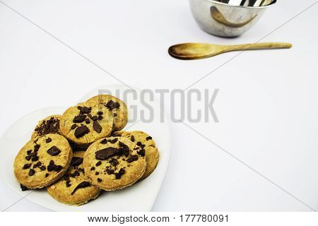 A plate of Gluten free Organic Homemade Chocolate Chip Cookies with mixing bowl in the background