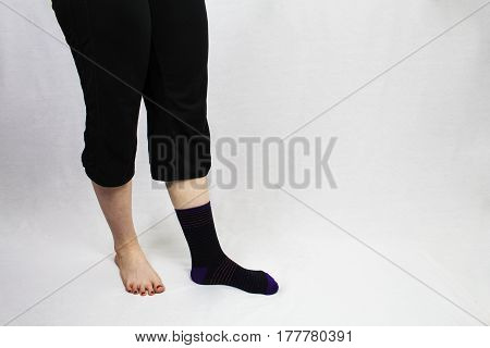 Female wearing one sock on one sock missing the old story of the missing sock