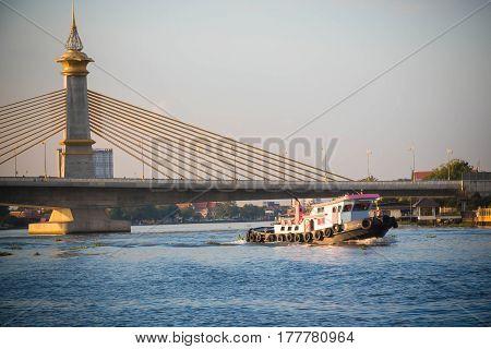 Chaopraya river and Maha Chesadabodindranusorn Bridge with a beautiful in Nonthaburi Province, Thailand.