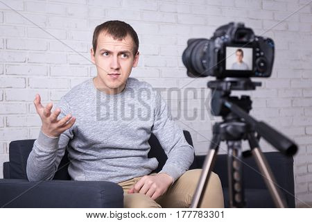 Video Blogger Making New Video At Home And Talking About Something