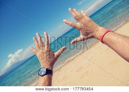 Enjoying the sea/ocean. Shallow depth of field on the hands.