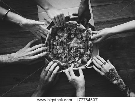 People Hands Grabbing Pizza from Delivery Box