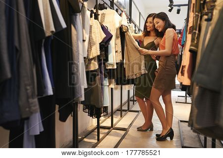 Attractive Asian women shopping in fashion boutique