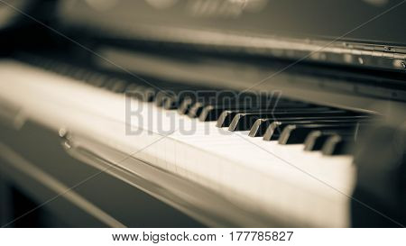 close up of an upright piano retro style