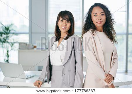 Portrait of pretty Vietnamese and Filipina business women