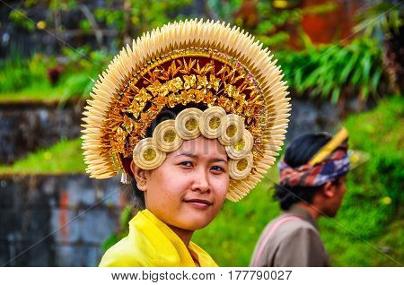 PURA BESAKIH, INDONESIA - SEPTEMBER 30, 2012: Beautiful woman in Pura Besakih Temple in Bali Island Indonesia