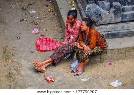 PURA BESAKIH, INDONESIA - SEPTEMBER 30, 2012: Balinese women in Pura Besakih Temple in Bali Island Indonesia
