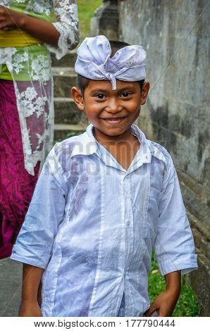 PURA BESAKIH, INDONESIA - SEPTEMBER 30, 2012: Balinese kid in Pura Besakih Temple in Bali Island Indonesia