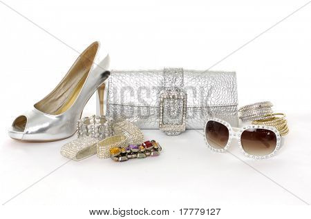 Female sunglasses and handbag with bangles ,shoe on white