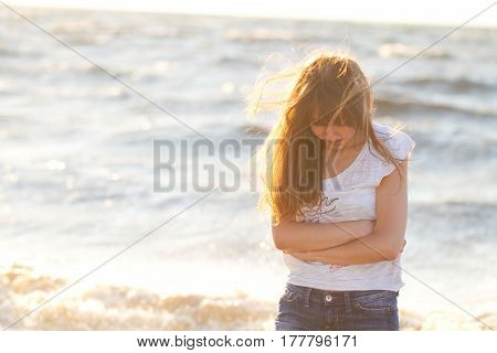 Young Beautiful Fair-haired Woman On A Plezha In Fine Summer Day