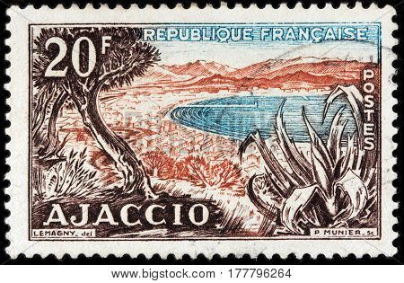LUGA RUSSIA - FEBRUARY 7 2017: A stamp printed by FRANCE shows beautiful view of Ajaccio - capital city of Corsica. Corsica is an island in the Mediterranean Sea circa 1954.