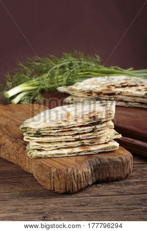 Scallion pancakes. Round unleavened flatbread minced green onions.