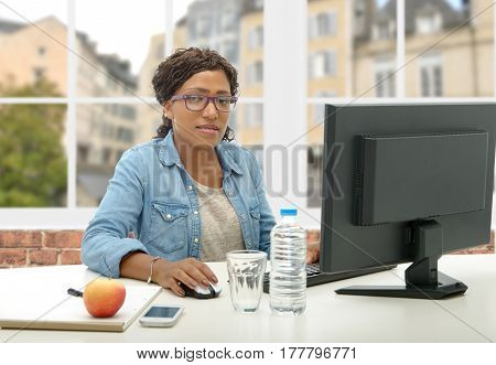 beautiful african american business woman working with computer