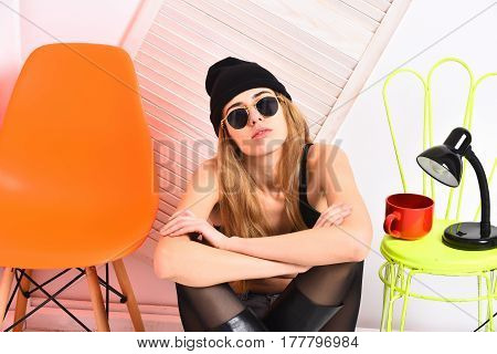 Pretty Sexy Woman In Sunglasses At Orange, Light Green Chair
