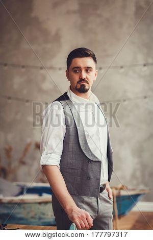 casual young man posing in loft interior