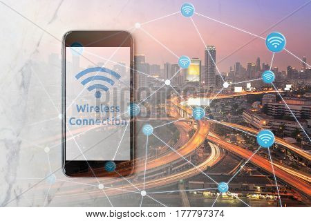 Smartphone with wifi network on screen and Smart city with wifi connection smart technology of internet of things. Photo design for smart city and smart technology internet of things concept