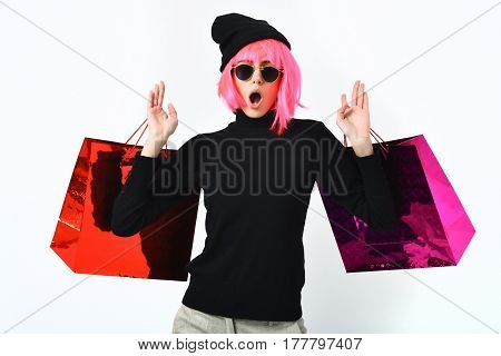 Fashionable Sexy Girl In Pink Wig Holding Package Or Bags